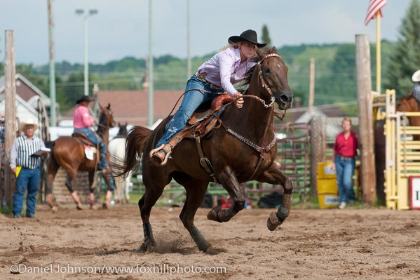 Barrel racing contestant at rodeo